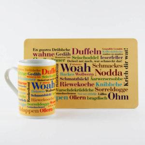 Frühstücksbrettchen und Kaffeebecher Siegerländer Wörter (2er Set)