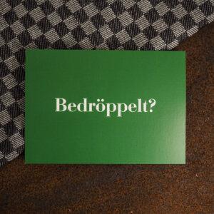 "Ruhrpott Postkarte mit dem Motiv ""Bedröppelt""."