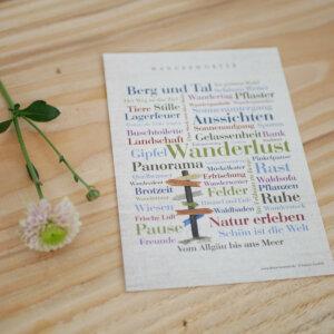Postkarte mit Wanderlust-Wörtern